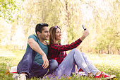 Couple in nature taking selfies