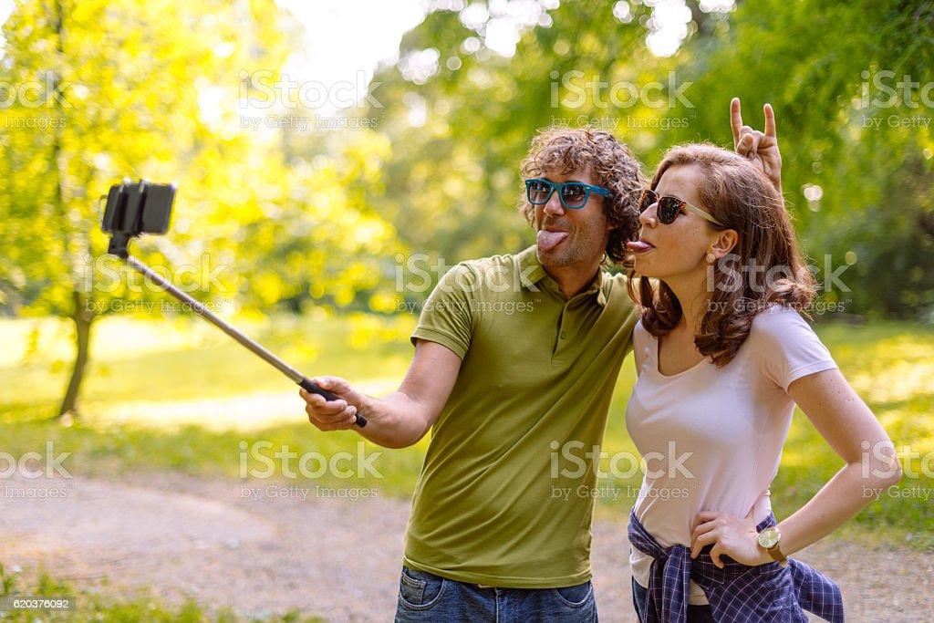Couple in park taking selfie stock photo