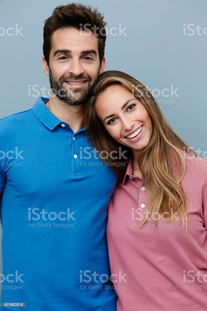 Couple in polo shirts, smiling stock photo