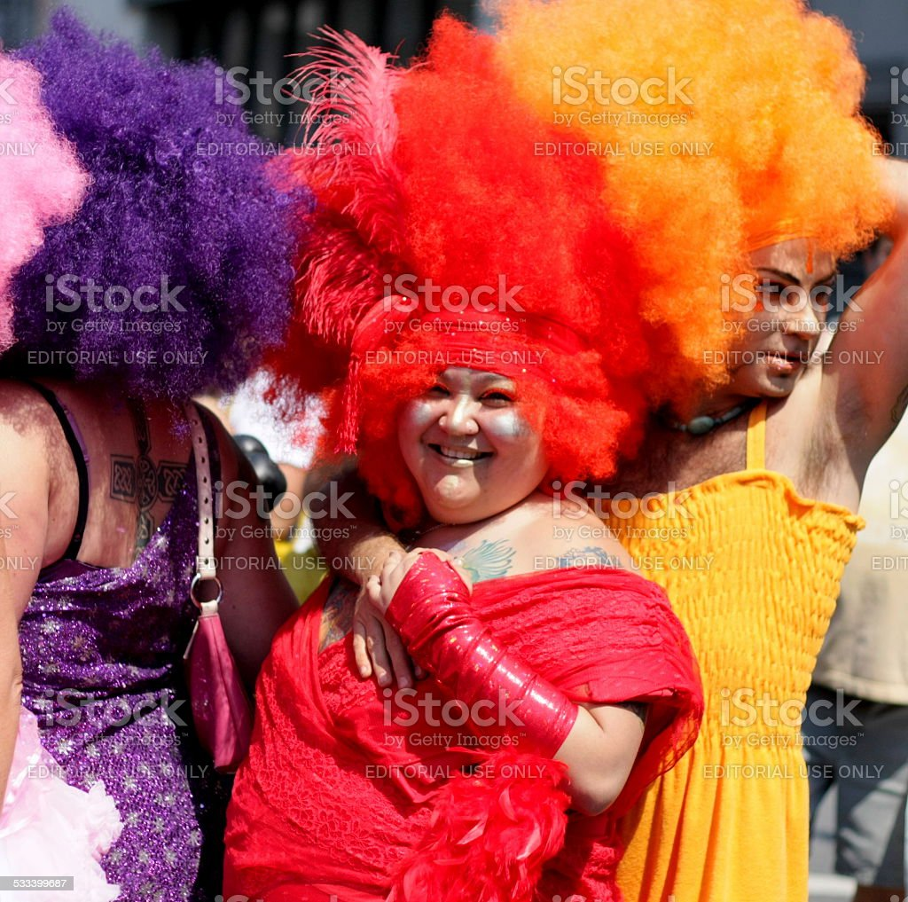 Couple in Red and Orange at Pride Parade stock photo
