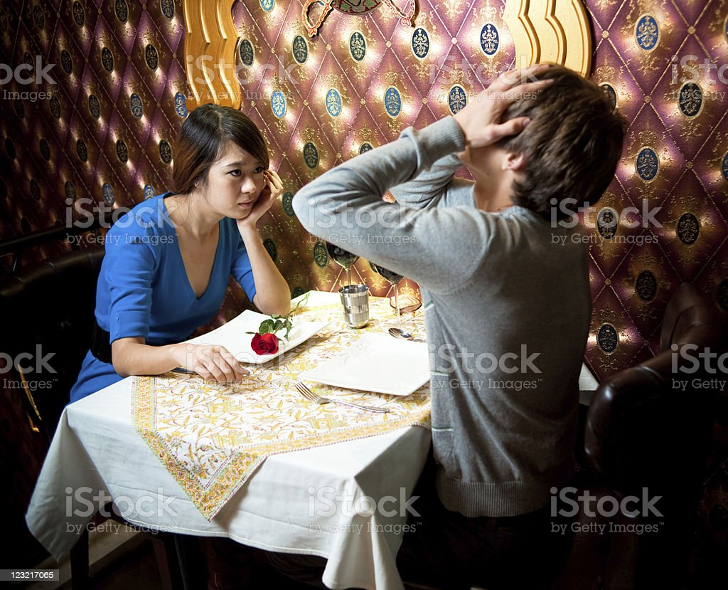 Couple in restaurant royalty-free stock photo