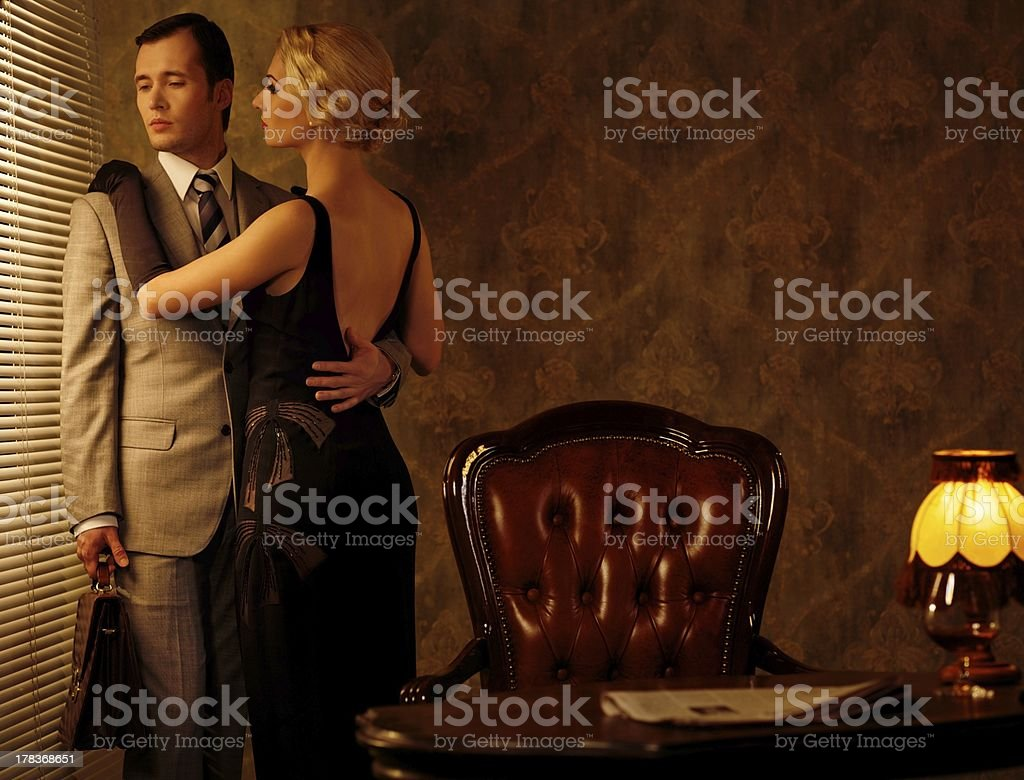 Couple in retro interior near a window royalty-free stock photo
