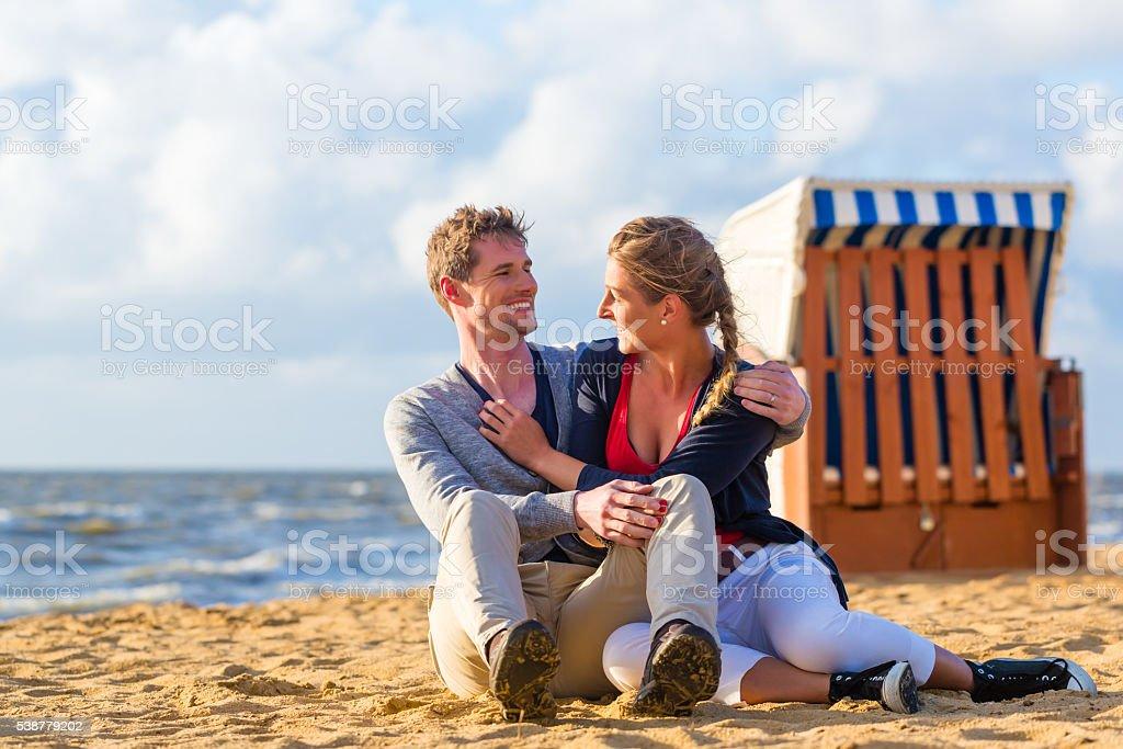 Couple in romantic sunset on beach stock photo