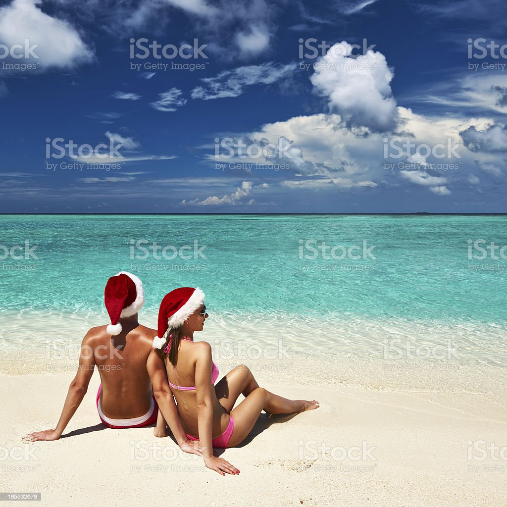 Couple in santa's hat on a beach at Maldives royalty-free stock photo