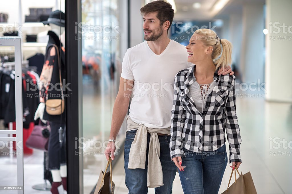 Couple in shopping mall stock photo