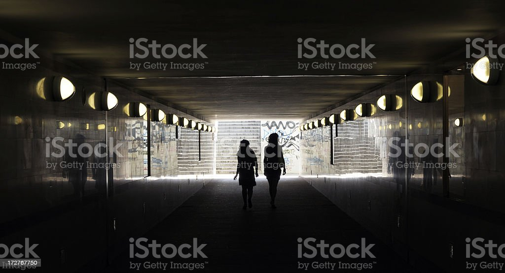 Couple in subway tunnel stock photo