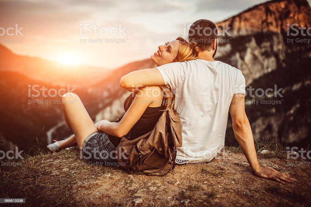 Couple in sunset stock photo