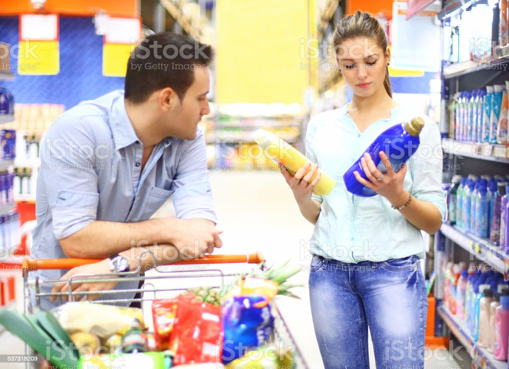 Couple in supermarket. stock photo