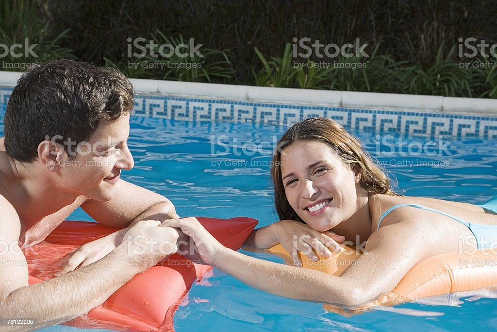 Couple in swimming pool royalty-free stock photo