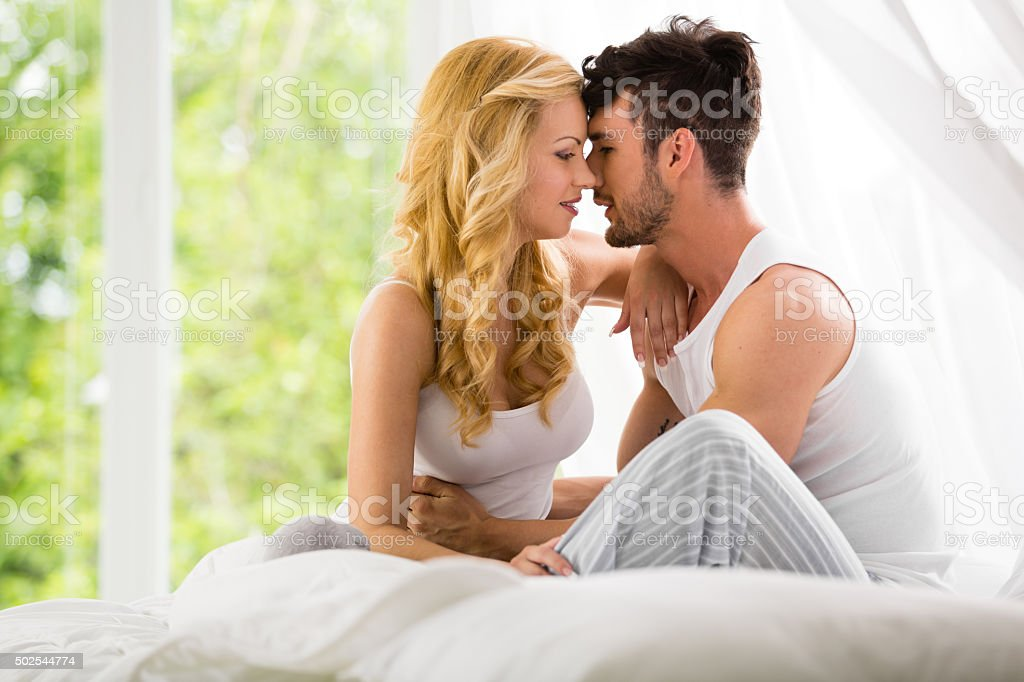 Couple in the bedroom stock photo