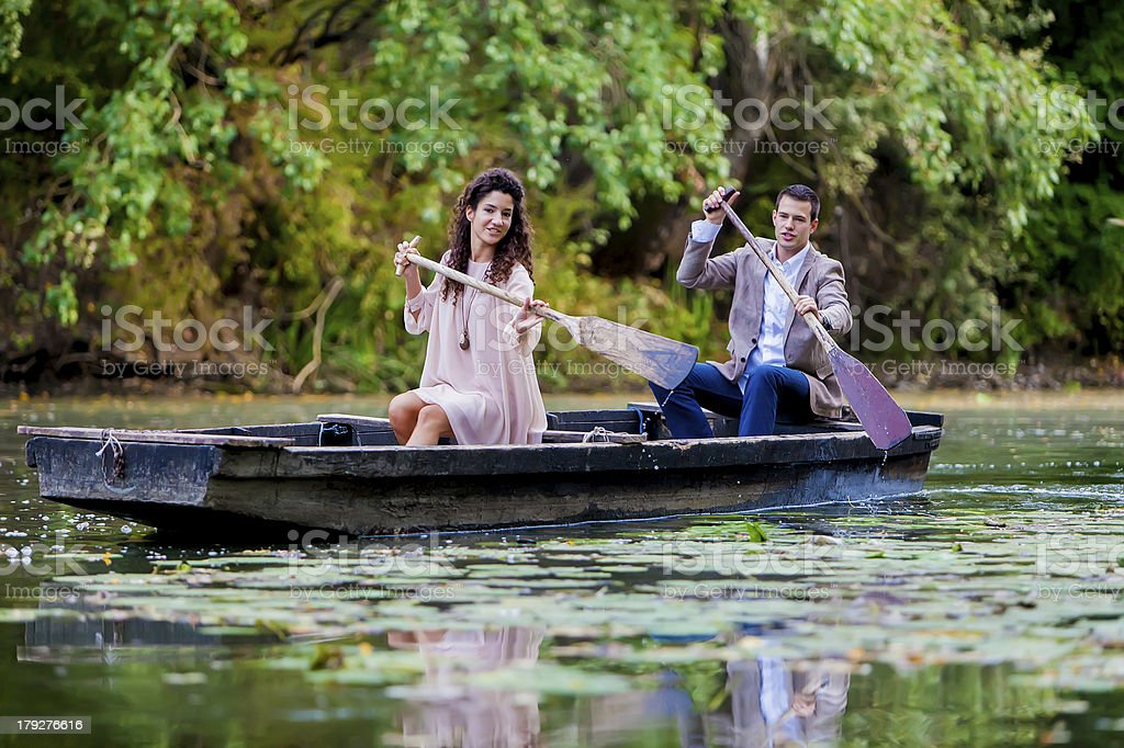 Couple in the boat royalty-free stock photo