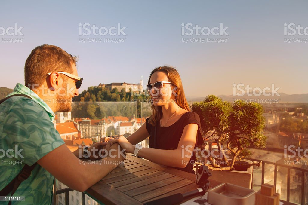 Couple in the cafe on the Neboticnik in Ljubljana, Slovenia. stock photo