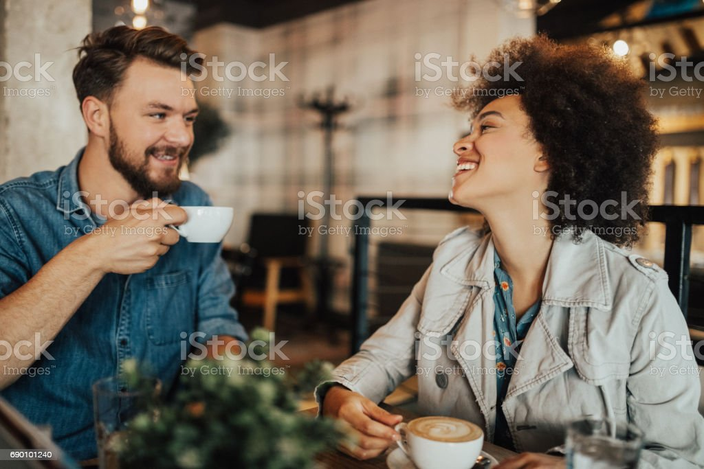 Couple in the coffee shop is drinking coffee stock photo