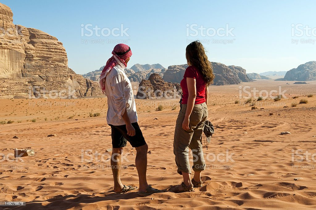 Couple in the desert in Petra, Jordan stock photo