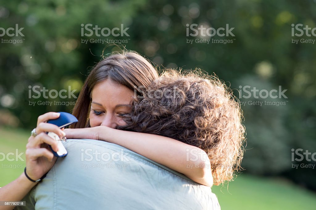 Couple in the park: Wedding proposal engagement stock photo