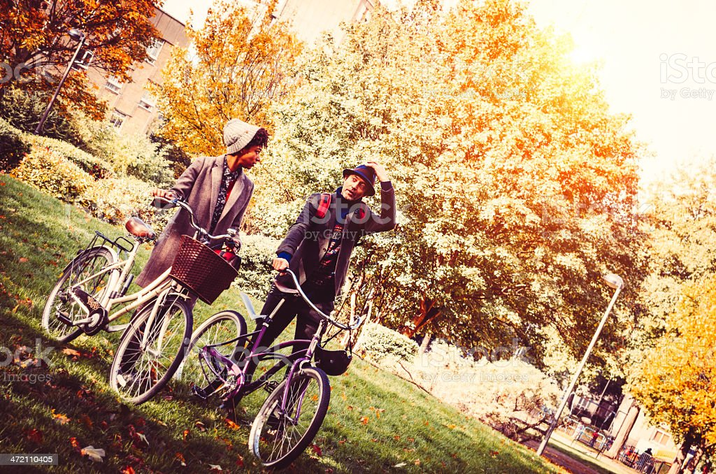 Couple In The Park With Bicycle stock photo