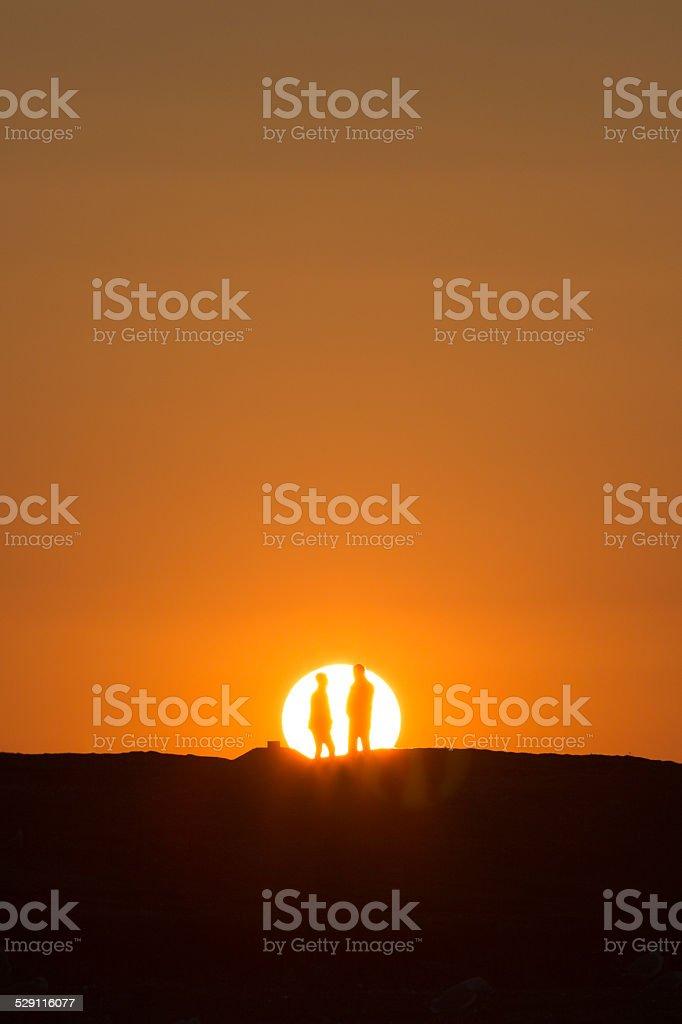 couple in the sun stock photo