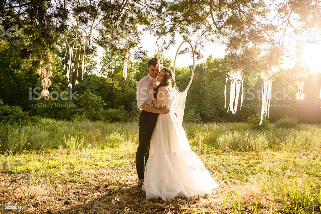 couple in the woods near amulets stock photo