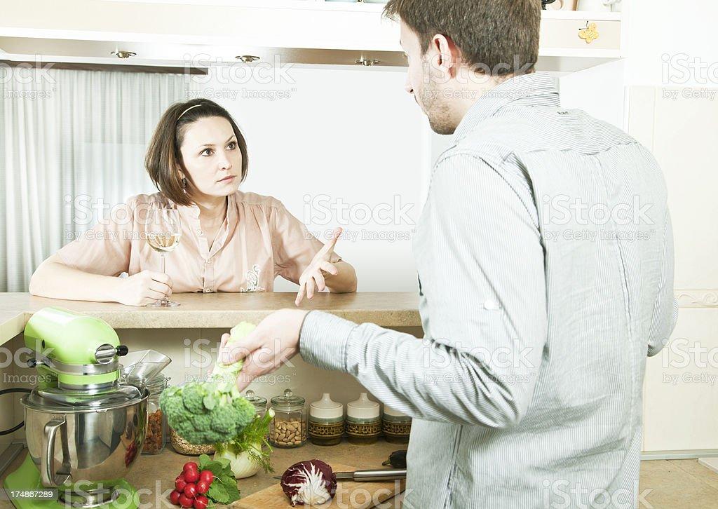 Couple in their kitchen royalty-free stock photo