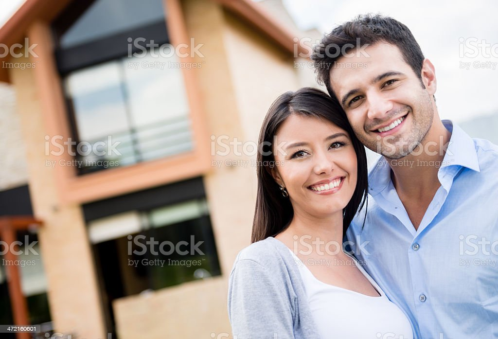 Couple in their new house stock photo