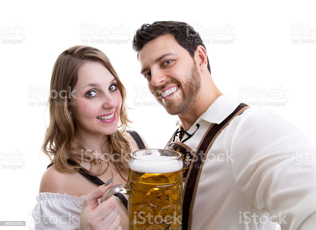 Couple in traditional bavarian costume on white background stock photo