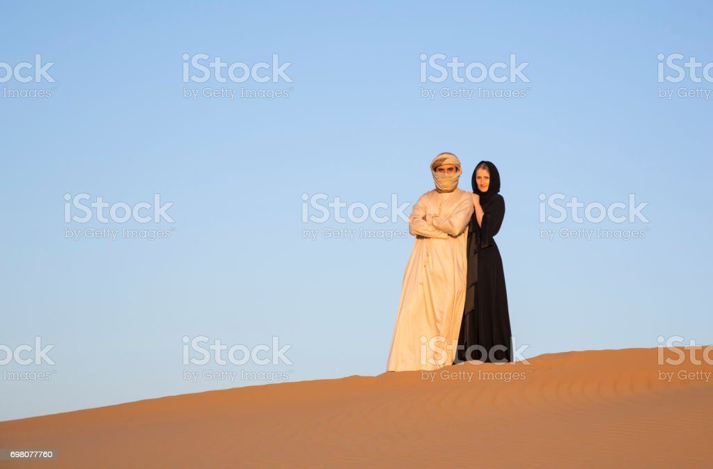 couple in traditional clothing in a desert stock photo