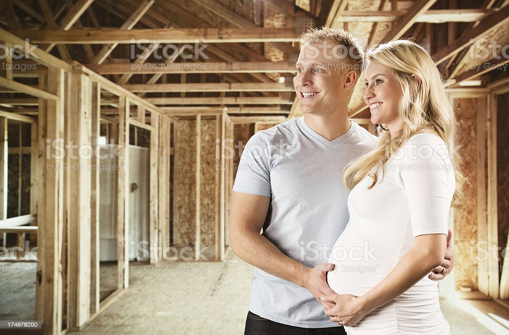 Couple in under construction house royalty-free stock photo