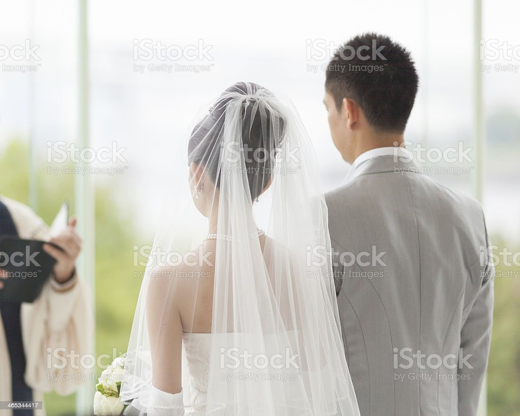 Couple in white wedding ceremony stock photo