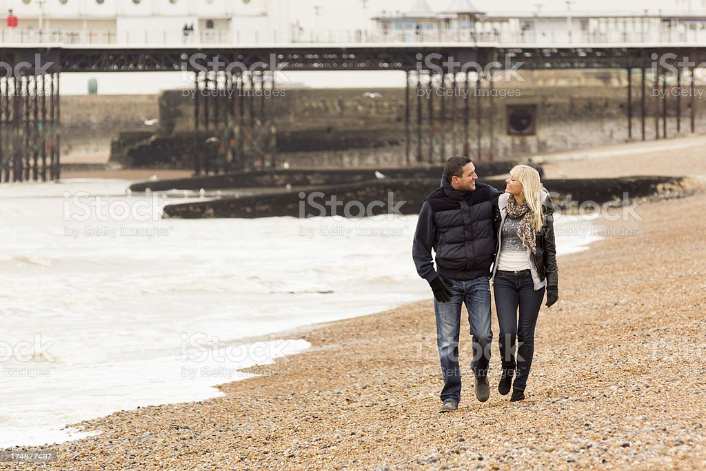 Couple in winter walk on beach at  seaside royalty-free stock photo