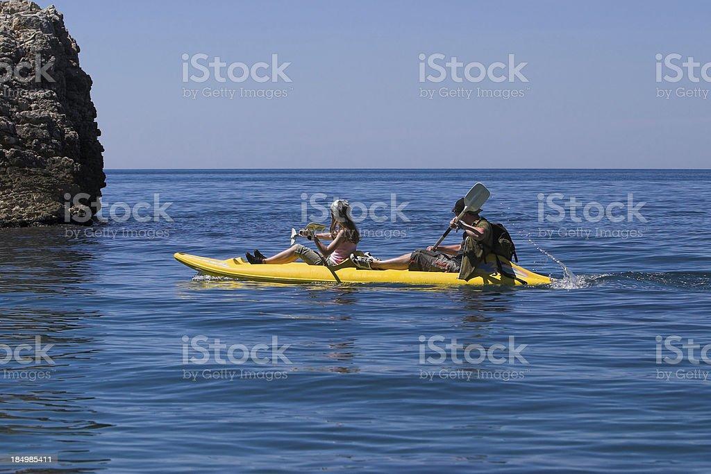 Couple in yellow kayak royalty-free stock photo