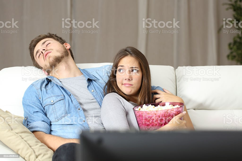 Couple incompatibility problems watching tv stock photo