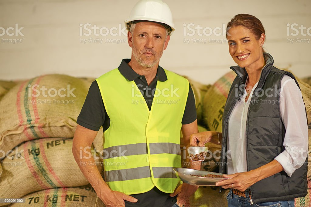 Couple inspecting inventory in large distribution warehouse stock photo