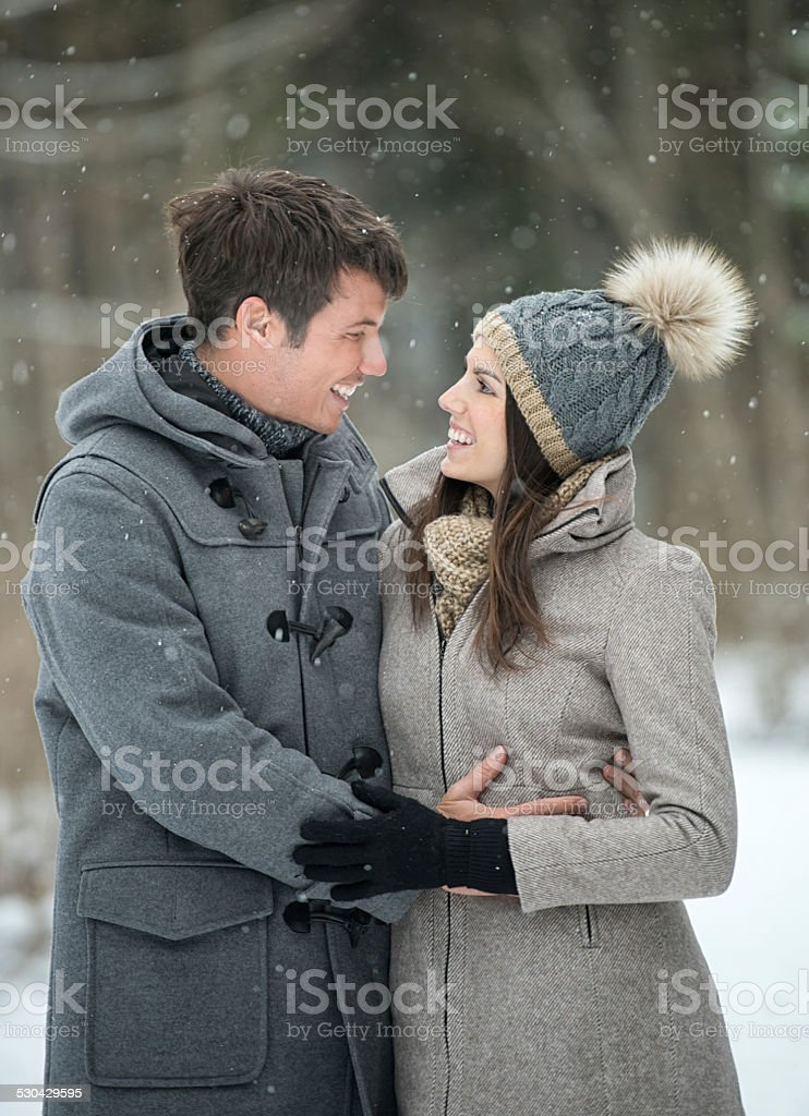 Couple interacting out in the Snow, Winter stock photo