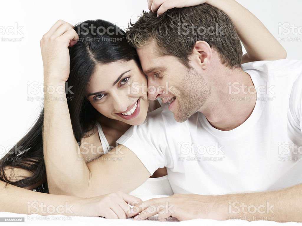 Couple intimate together loving and smiling stock photo