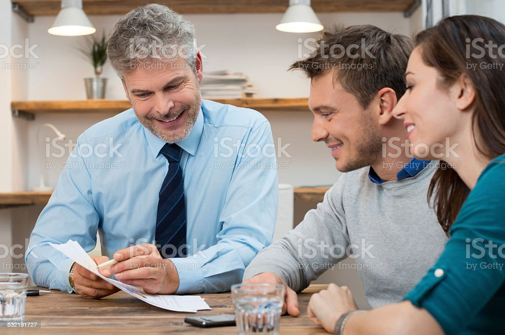 Couple invest their savings stock photo