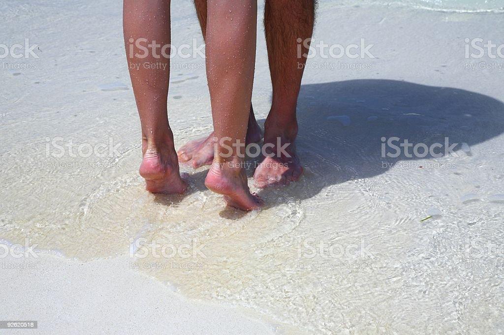 Couple is on the sandy beach stock photo