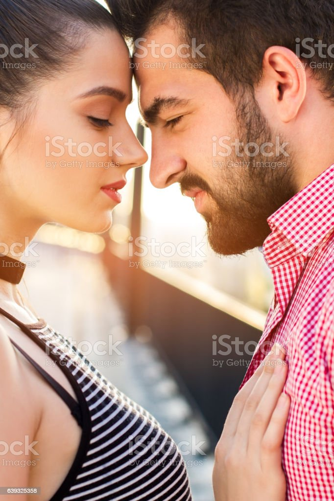 Couple is touching foreheads. stock photo