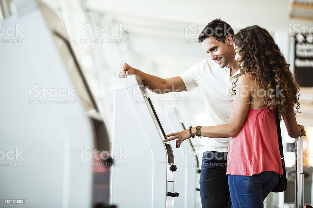 Couple is using quick checkin at airport stock photo