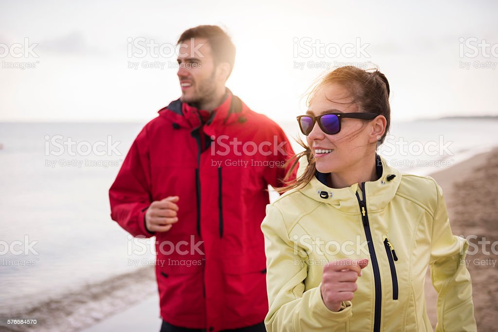 Couple jogging in the bad weather stock photo