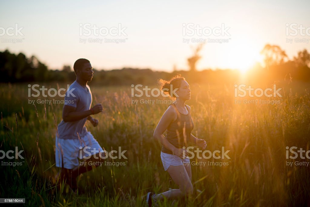 Couple Jogging in the Sunset stock photo