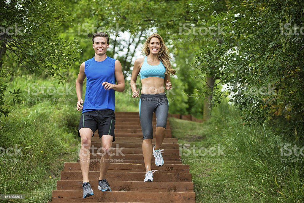 Couple Jogging On Staircase royalty-free stock photo