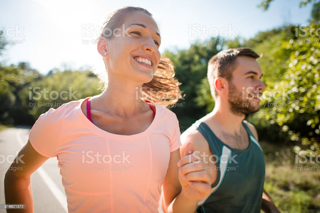 Couple jogging together stock photo