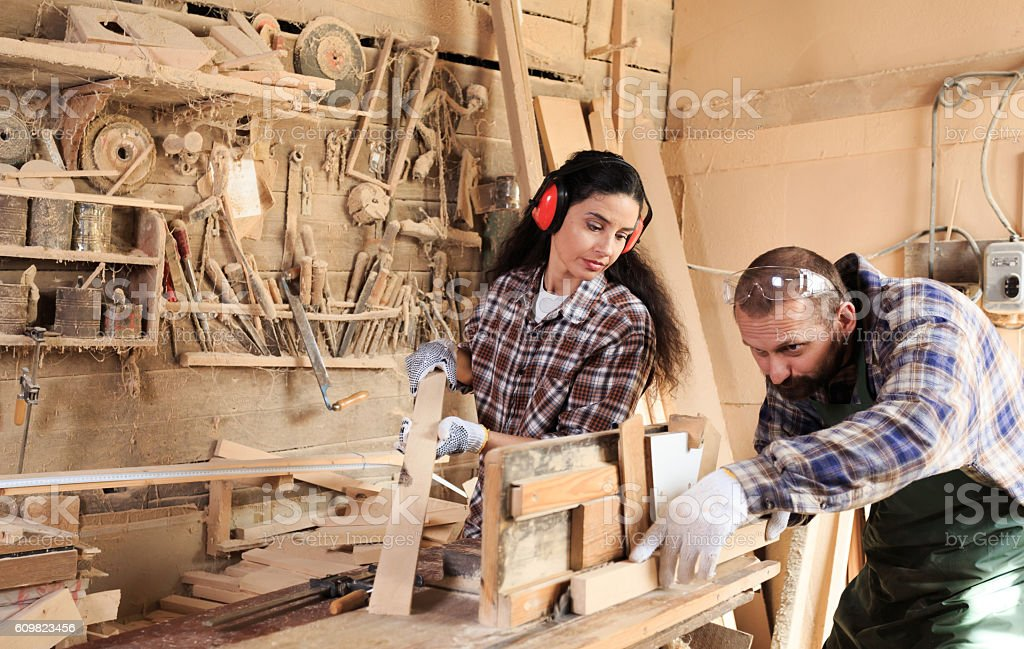 Couple joiners working in their workshop stock photo