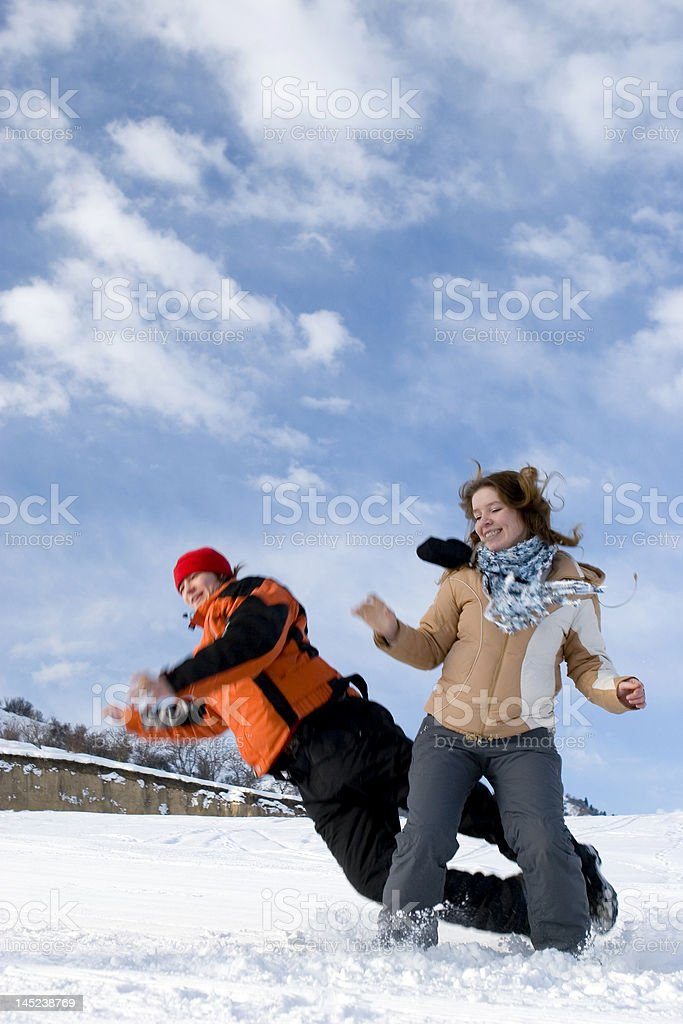 Couple jump over blue sky in winter royalty-free stock photo