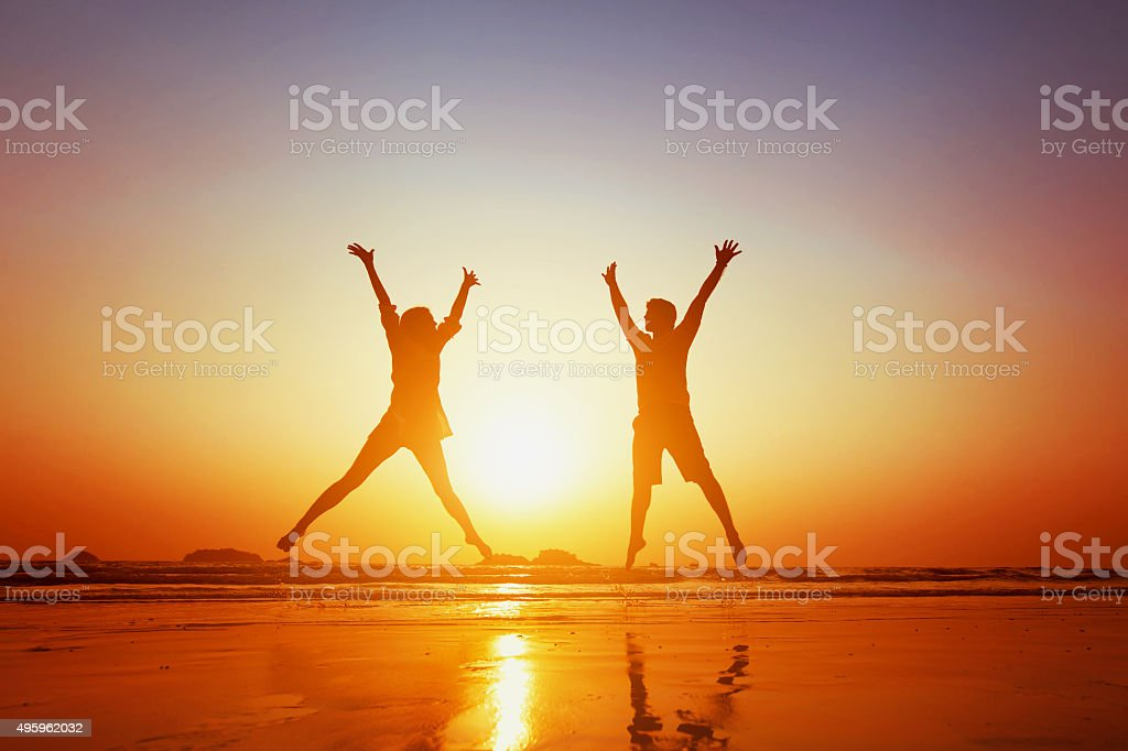 couple jumping stock photo