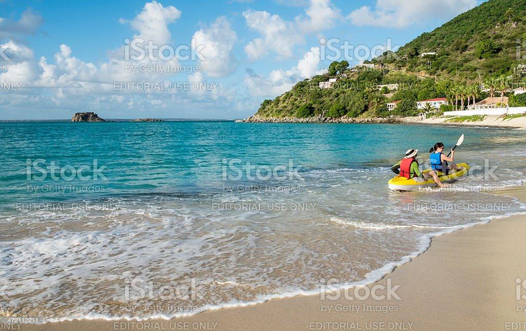 Couple Kayaking in the Caribbean Sea stock photo