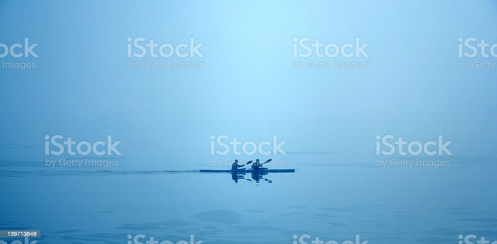 Couple kayaking in the morning stock photo