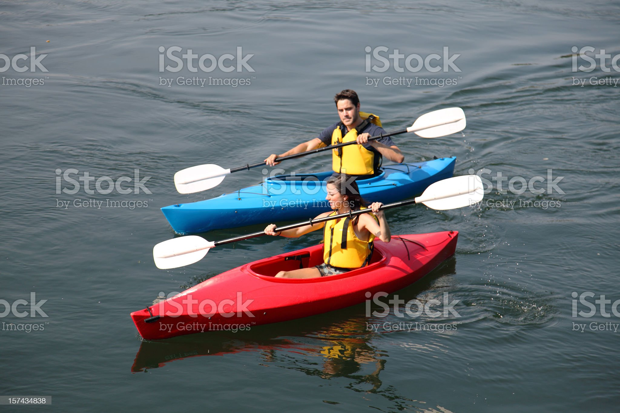 Couple Kayaking On The River royalty-free stock photo