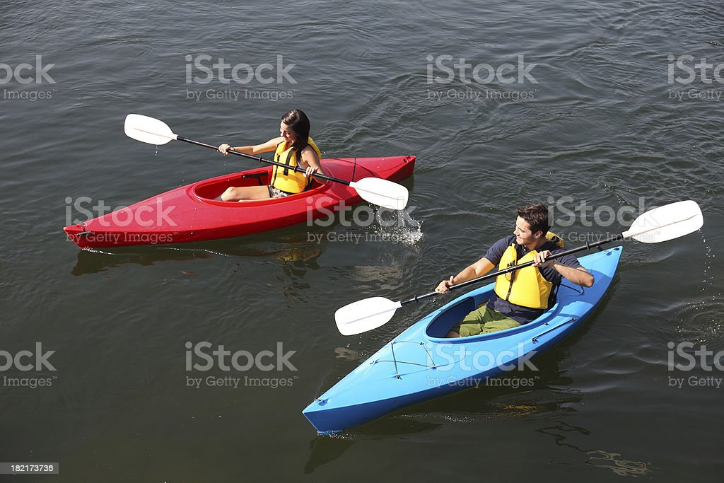 Couple Kayaking On The Water royalty-free stock photo