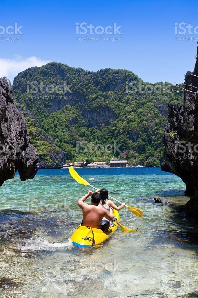 couple kayaking stock photo